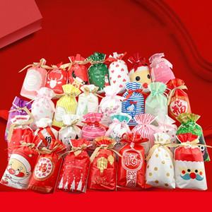 20 جهاز كمبيوتر شخصى عيد ميلاد سعيد الرباط الأختام البلاستيكية حقيبة الكوكيز كاندي حقائب بابا نويل هدية أكياس بلاستيكية