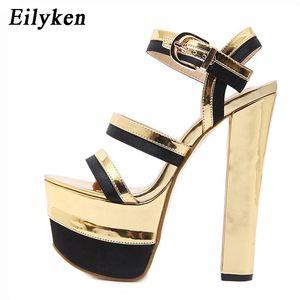 Eilyken Gladiator Mulheres Sandálias Pumps Shoes Sexy Golden Stage Super alta capa sapatos de salto da bracelete Sandálias 2020 Verão Y200702