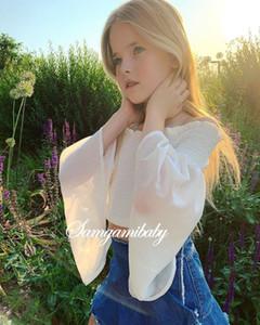 Muchachas de la manera del dril de algodón trajes nuevos niños del estilo americano europeo blancos falbala elástica de la llamarada de la manga tops + borla de mezclilla falda 2pcs conjuntos A1974