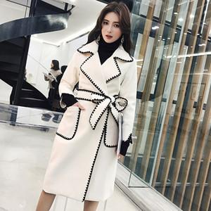 Escudo decoración breasted doble nueva chaqueta informal manera de las mujeres suelta más larga de las mangas de la solapa de Trench