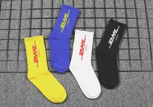 Mens Designer Calze Street Fashion Marca Socks Media tubo universitari stile lettera cotone Skateboard Sport Socks 4 colori