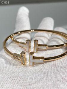 Al por mayor del diseñador clásico del oro 14K plateado Cerámica blanca y cristal doble del encanto de TT brazalete abierto de la joyería para las mujeres
