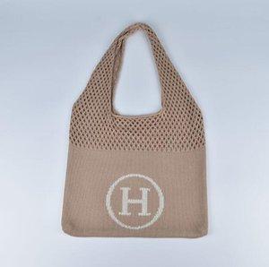 Gran capacidad de tejer bolso de las mujeres Carta ahuecado la malla de tejido de punto bolsos femeninos de un hombro