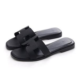 Nuove donne in vera pelle pantofole tagliate i sandali da spiaggia estivi