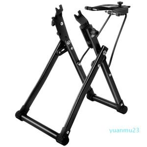 Mayor-caliente rueda de bicicleta truing base para el hogar de centrado mecánico Soporte Mantenimiento Inicio ayuda del sostenedor de bicicletas Reparación de Herramienta