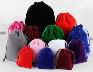 50pcs sacchetti di velluto MP3 / MP4 / gioielli regalo del partito sacchetti con coulisse sacchetti di immagazzinaggio di natale favore di nozze titolare display 7x9 cm