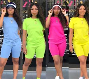 Nueva ropa de las mujeres del verano de manga corta Pantalones cortos Trajes 2 piezas traje Conjunto de deporte del deporte que activan la camiseta camiseta de la manera Sólido + cortocircuitos