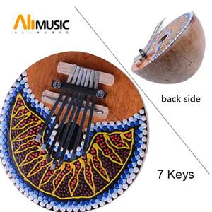 7 مفاتيح Kalimba الإبهام البيانو ضبط جوز الهند قذيفة رسمت آلة موسيقية