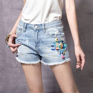ARTKA Summer Women Cotton Denim Shorts Elastic Floral Printed Pocket Pattern Holes Design Female Blue Jeans Shorts KN11072X T200701