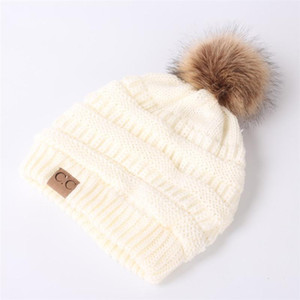 New Foreign trade Europe and America autumn and winter CC labeling knit hat Women Wool ball Wool hat