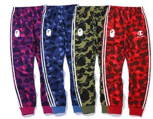 Осень Streetwear Новая мода Hip Hop Брюки Хит Цвет Stripes Письмо Женщины Мужчины Упругие штаны скейтборд Sweatpants