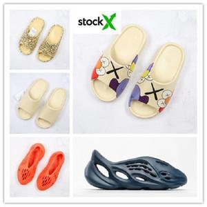 Della nuova schiuma corridore Kanye sandali zoccoli ovest tripla nero scivoli bianchi dei pistoni di modo delle donne degli uomini del progettista spiaggia sandali infradito 36-45