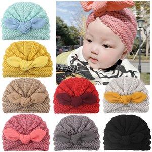 Las orejas por mayor unisex para niños pequeños sombreros de punto turbante de conejito del arco sombreros para las niñas pequeñas de los niños abrigo de la cabeza diadema sólido Niños color del caramelo de las lanas del casquillo