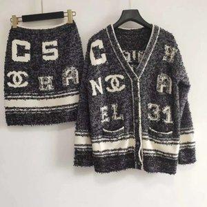 312 2020 mujeres del resorte suéter de manga larga con cuello en V Regular Cardigan + falda con paneles Marca suéter ropa de las mujeres DL