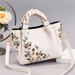Designer de luxo Handbag Mulheres Designer Shoulder Bag New Outono e Inverno de alta qualidade tricô Hand Held Moda Flor Bordados
