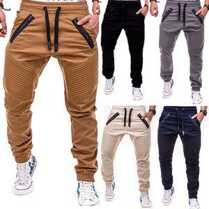 Hombres del basculador de la cremallera bolsillos de los pantalones largos otoño llegada Hombre flaco Fit carretera Diseñador Chino Hip Hop estira los pantalones del color sólido
