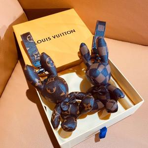 Novíssimo chaveiros Chaveiro Designer saco de carro de luxo chaveiro do chaveiro de couro do monograma de aço inoxidável keychain casal com caixa