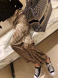 El último diseño de la Mujer de pierna ancha pantalones de terciopelo Cuelgue sentido de otoño / invierno pantalones holgados Doble G imprimir pantalones casuales