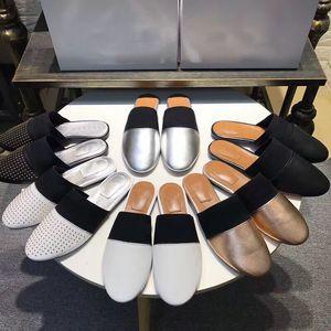 Кожа Alphabet Hotel Cartoon Тапочки заклепки Баотоу Тапочки на плоской подошве роскошные Дизайнерские тапочки для отдыха Мягкая кожаная женская обувь Размер 42