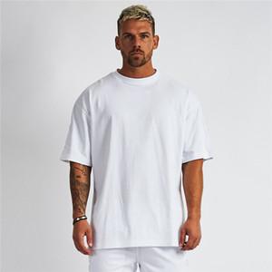 T-shirts blanc couleur solide culturisme lâche remise en forme à manches courtes T-shirt des hommes chemise demi-manches hommes de marée perméable à l'air de grande taille hommes