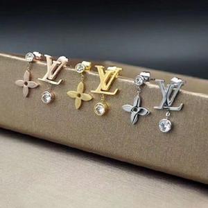 ارتفعت فاخر مصمم المجوهرات النسائية الأقراط أربع أوراق أقراط زهرة الذهب والفضة الساعات Elagant غير متناظرة إلكتروني V مع الماس