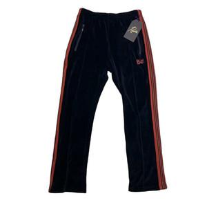 Mens pantalones AGUJAS Negro terciopelo rojo bordado de la mariposa sueltos pista Casual Pantalones Moda Sweatpants