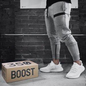 Calças cintura cor sólida Pantlones Designer Zipper Feixe decorativa Calças Corredores Sweatpants Roupas para homens faixa Pant Mens Athletic Elastic