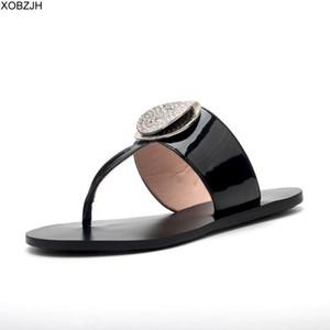 XOBZJH Donne Estate Calzature Flip flop sandali piatto 2020 di cuoio delle signore del partito strass nero di modo di pantofole di scarpe Donna