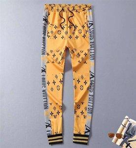 Lo nuevo diseñador del Mens Pantalones Streetwear hombres de lujo Sweatpants Cartas Strped lateral Joggers Track Pant Ropa M-2XL