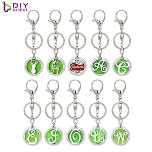 316 Stainless Steel Fashion Silver Perfume Round Locket Essential Oil Diffuser Keychain (Free Pad) AA265-268-Y02