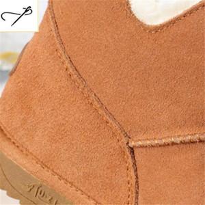Botas de nieve de moda de alta calidad Botas de cuero de piel de vaca genuino Botas de invierno cálido Fox Pom-Pom Style Tobillo Zapatos de invierno Rosa