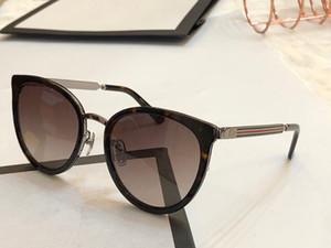 New fashion designer sonnenbrille 0077 metallrahmen frauen beliebte cat eye brille top qualität charmante stil uv400 marke eyewear mit paket