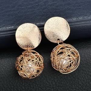 Geometric style earrings. Simple hand-knitted ball. Metal earrings. Vintage ladies jewelry