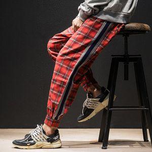 Moda hombre pantalones sueltos Lattice Stripe joggers tobillo pantalones bolsillos verde rojo pantalones de chándal Harlan pantalon homme