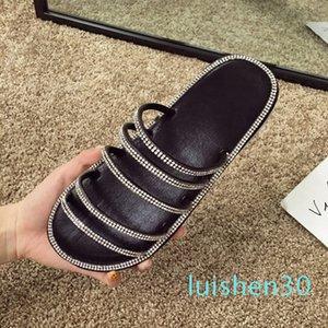 sandalias y zapatillas de las mujeres 2020 del dedo del pie abierto zapatillas planas de diamantes de imitación salvaje nueva moda de verano sandalias femeninas y AL30