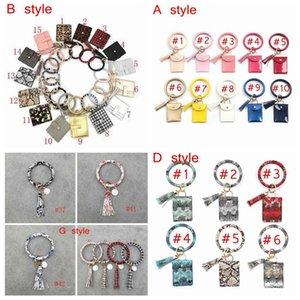 Bracelet Carte Sac Porte-monnaie Keychain Bracelet léopard sac à main en cuir Keyring Bracelet Trousseau PU Bracelet en cuir d'embrayage avec pompons ZZA2305