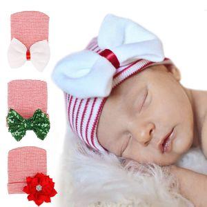 Recién nacido lentejuelas de Navidad grande del arco sombreros del bebé de punto de ganchillo casquillos calientes infantil Skull Beanie Invierno cinta rayada Cap neumáticos Bowknot 4styles M757