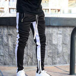 Мужские бегуны повседневные брюки Фитнес Мужчины Спортивная одежда Спортивные костюмы Bottoms Узкие Sweatpants Брюки Черные Спортзалы Jogger Тренировочные брюки