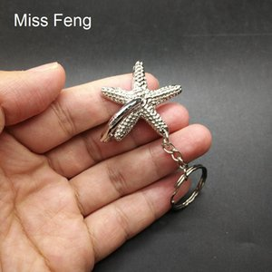 H503   Novelty Collection Starfish Ring Puzzle Metal Model Brain Teaser Gift Toy Mini Puzzle With Key Ring