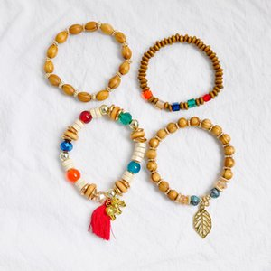 F&U 4pcs set Multilayer Wood BeadsTassel and leaves Charm Jewelry Strand Stretch Boho Yoga Mala Bracelets Bangles Pack for Women