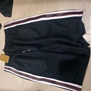 Moda para hombre Pantalones cortos Pantalones deportivos de calidad superior del basculador Ropa lado de la raya con cordón Bragas de los hombres del deporte Sudor Trouse