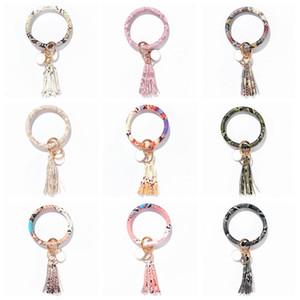 Tassel Bracelets porte-clés en cuir PU Bracelet Porte-clés Porte-clé O filles Bague Bracelet Bracelet Wristband Keyring Party Favor cadeaux D7112