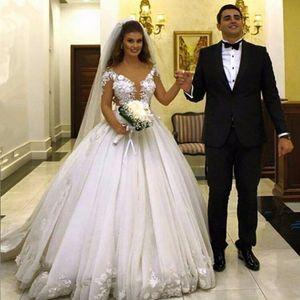 Sexy Illusion Top Ballkleid Brautkleider 3D Blume Appliques Sheer Langarm Hochzeit Kleid Schicht Rock AbriD Dubai Brautkleid