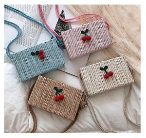 Monederos para niños 2019 accesorios más nuevos de Corea cereza linda paja pequeño cuadrado Bolsas muchachas de la manera cruzada de cadena del cuerpo bolsas de regalos de cumpleaños