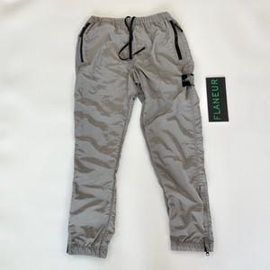Il progettista del mens pantaloni di nylon Meatl Pantaloni funzionali Tuta Moda marchio sportivo Pantaloni Casual alta fitness Long Street