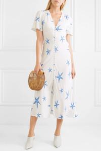 Vestido a media pierna de crepé con estampado de jade crepé blanco y tonal azul Cierre de botones en la parte delantera