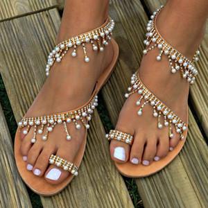 sandalias de las mujeres del tamaño 2019 últimos zapatos de verano de la caída de la cadera nuevo diseño de la perla plana zapatillas cadena de perlas playa damas calzado universal gran ventaja 35- 43