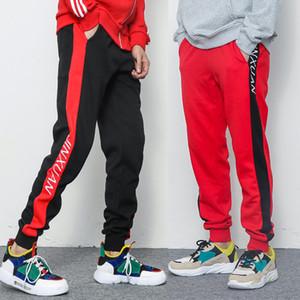 Homens Novos painéis suam Os Pants impressão Stripe bolsos laterais Sweatpants Corredores Casual soltas masculinos Sportswear Calças