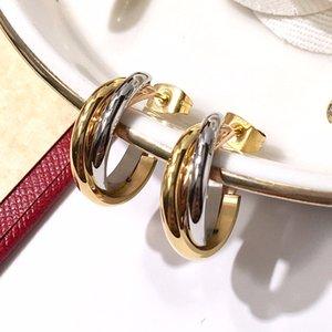 Clou d'oreille C classique en acier titane à trois couleurs et à trois anneaux de la mode symbolise l'amour, l'amitié et les bijoux de famille