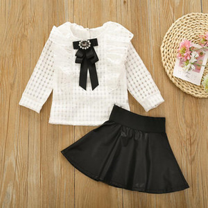 Baby Outfits INS Girls Hollow Long Sleeve Plaid Bow Tie Shirt + PU Leather Skirts 2pcs set Fashion Boutique Kids Clothing Sets